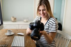 Portrait of young woman designing at home royalty free stock photos