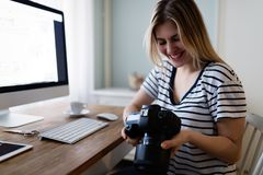 Portrait of young woman designing at home Royalty Free Stock Image