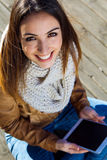 Portrait of young woman with digital tablet Royalty Free Stock Photography