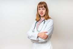 Portrait of young woman doctor with arms crossed Stock Photo