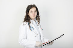 Portrait of young woman doctor, holding a folder. looking at camera. Stock Photos