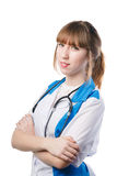 Portrait of young woman doctor. With white coat standing  in hospital Stock Photography