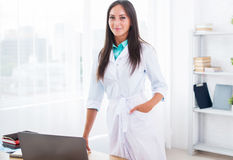 Portrait of young woman doctor with white coat Stock Photography
