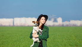 Portrait of young woman with dog Royalty Free Stock Images