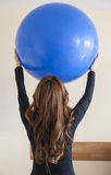 Portrait of young woman doing physical therapy exercises Royalty Free Stock Photo
