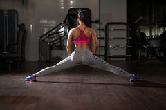 Portrait Of Young Woman Doing Stretching Exercise Royalty Free Stock Images