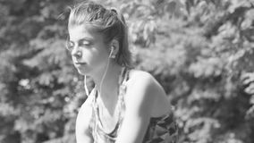 Portrait of young woman doing yoga exercises. Black and white. Close up portrait of young woman doing yoga exercises in the park stock video footage