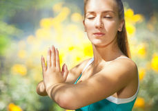Portrait of young woman doing yoga outdoor Royalty Free Stock Photos