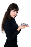 Portrait of young woman dreaming to purchase a new car against w. Hite background Royalty Free Stock Images