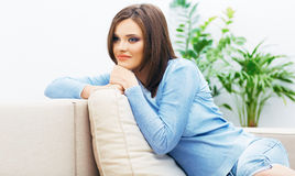 Portrait of young woman dressed in blue casual clo Royalty Free Stock Photos