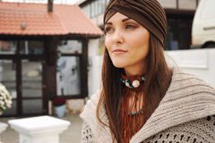 Portrait of a young woman dressed in fashion hat and boho style accessories Royalty Free Stock Images