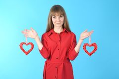 Portrait young woman dressed in red dress holding symbol heart in hand stock image