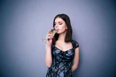 Portrait of a young woman drinking champagne Stock Photos
