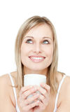 Portrait of a young woman drinking cofee Stock Image