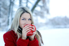 Portrait of a young woman drinking coffee Stock Photo