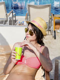 Portrait of  young woman  drinking coffee  on the beach. Portrait of  young woman  drinking coffee on the beach .Summer holiday Stock Photography