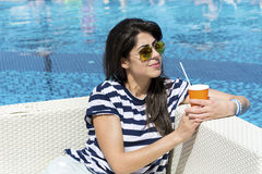 Portrait of  young woman  drinking coffee  on the beach. Portrait of  young woman  drinking coffee on the beach .Summer holiday Stock Images