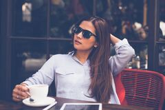 Portrait of Young Woman Drinking Coffee at Home Royalty Free Stock Photography