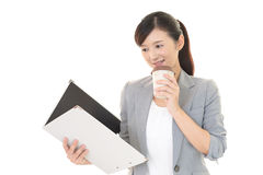 Portrait of young woman drinking coffee. Royalty Free Stock Images
