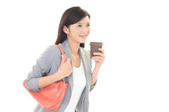Portrait of young woman drinking coffee. Stock Photos