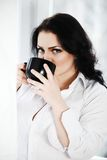 Portrait of young woman drinking a cup of coffee. Stock Photography