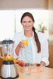Portrait of a young woman drinking fresh fruits juice Stock Photos
