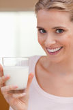 Portrait of a young woman drinking a glass of milk Stock Images