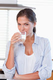 Portrait of a young woman drinking a glass of water Stock Photo