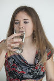 Young Woman with Beautiful Green Eyes Drinking Glass of Water Royalty Free Stock Images