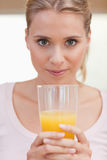 Portrait of a young woman drinking juice Stock Photos
