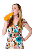 Portrait of young woman drinking juice Royalty Free Stock Images