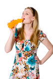 Portrait of young woman drinking juice Royalty Free Stock Image