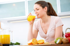 Portrait of young woman drinking orange Juice Royalty Free Stock Images