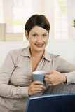 Portrait of young woman drinking tea Royalty Free Stock Images