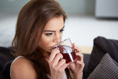 Portrait of young woman drinking tea Stock Image