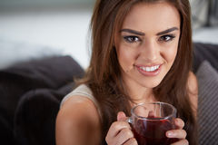 Portrait of young woman drinking tea Royalty Free Stock Photos