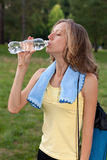 Portrait of young woman drinking water Royalty Free Stock Photo