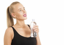 Portrait Of Young Woman Drinking Water After Jogging Stock Photography
