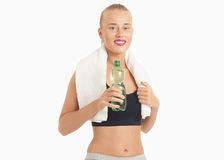 Portrait Of Young Woman Drinking Water After Jogging Royalty Free Stock Images