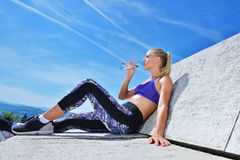 Portrait Of Young Woman Drinking Water After Jogging Stock Photos