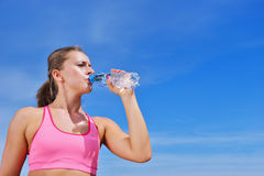 Portrait Of Young Woman Drinking Water After Jogging Stock Images