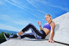 Portrait Of Young Woman Drinking Water After Jogging Royalty Free Stock Photography
