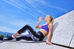 Portrait Of Young Woman Drinking Water After Jogging Royalty Free Stock Image