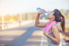 Portrait of young woman drinking water Stock Photos