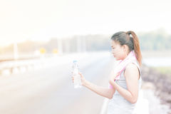 Portrait of young woman drinking water Stock Photo