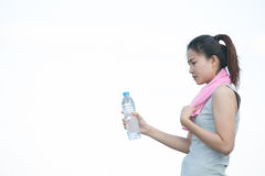 Portrait of young woman drinking water Stock Images