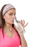 Portrait of young woman drinking water after sporting, on white Stock Photography
