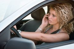 Portrait of young woman driving car Stock Images