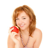 Portrait of a young woman eating an apple Royalty Free Stock Image