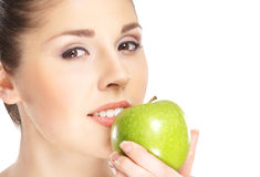 Portrait of a young woman eating an apple Stock Image
